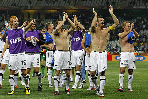 New Zealand football team celebrating after the draw against Italy at the South Africa 2010 World Cup