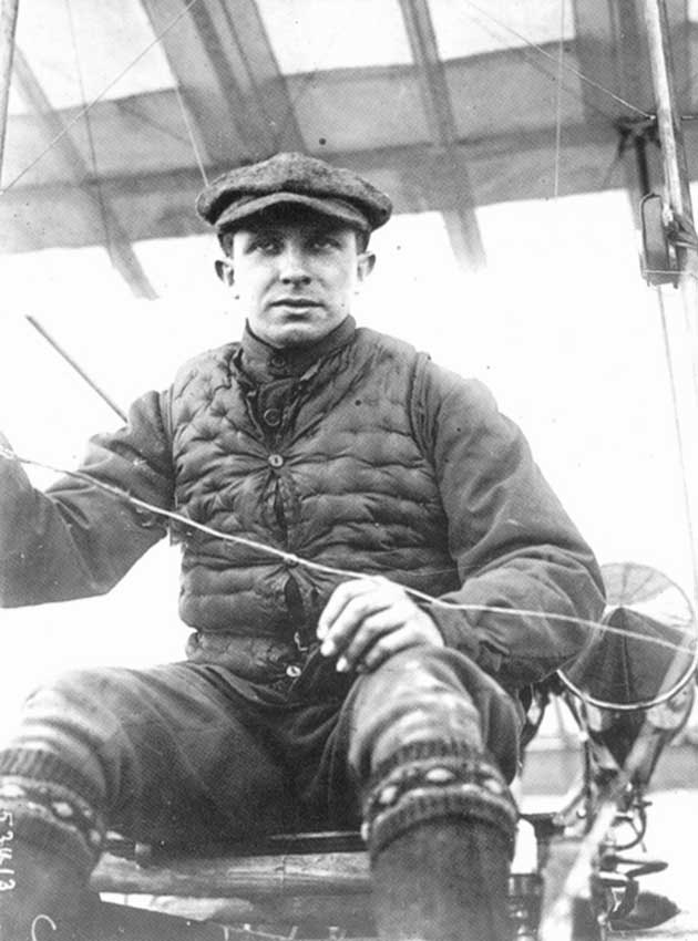 Geo Chavez (sitting on his plane, front view)